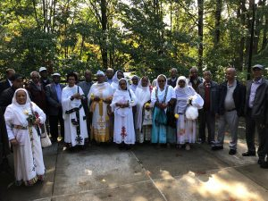 Group Photo at East African Elders Meal during the Coffee Roasting Ceremony